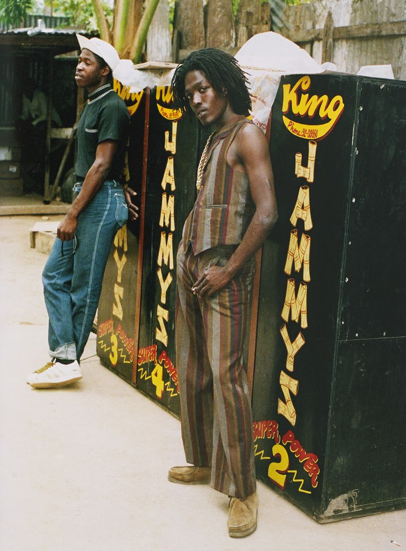 Singer Junior Reid wearing Wallabees and pants length with matching waiscoat, King Jammy's yard, Kingston 1986. Photgraph © Beth Lesser