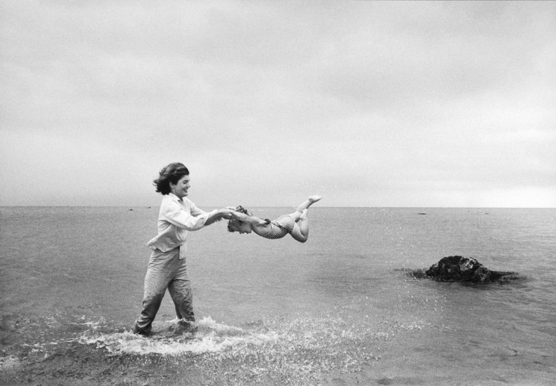 Jackie swings Caroline in the shallows at Hyannis Port, 1959 © Mark Shaw / mptvimages.com
