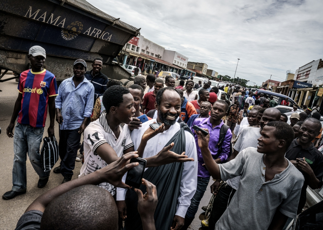 Jesus of Kitwe (born Mupeta Chishimba) proselytizing in a market place. Big crowds gather, recording his every word on their mobile phones. Zambia, 2015 | © Jonas Bendiksen/ Magnum Photos