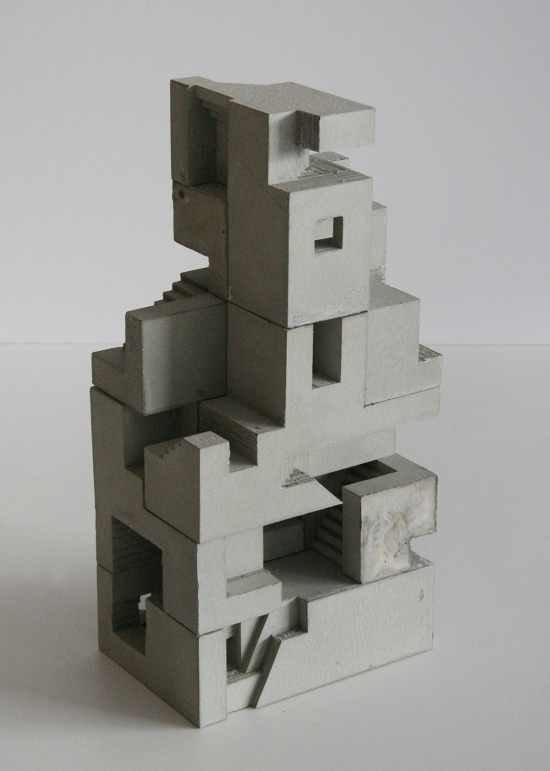 Miniature concrete sculptures of Brutalist structures can be used like grown-up Lego