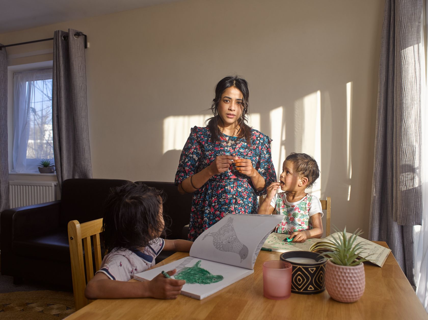 Holding the Baby: Photographer Polly Braden offers a glimpse into the lives of single-parent families on the poverty line