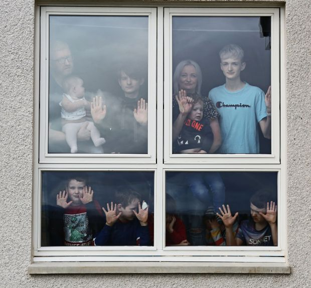 Grandparents and grandchildren visiting in isolation © Chris Page; Alexis and David Brett with nine of their sons and baby daughter, isolating in their home in Dingwall © Peter Jolly
