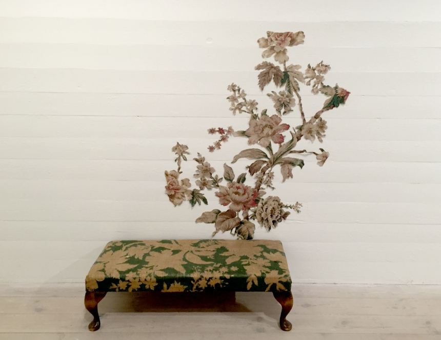 Janne Malmros, Unfold, 2007, floral pattern on a period, English oak foot-stool, cut out in one piece and arranged on wall, 35 x 96 x 107 cm (1)