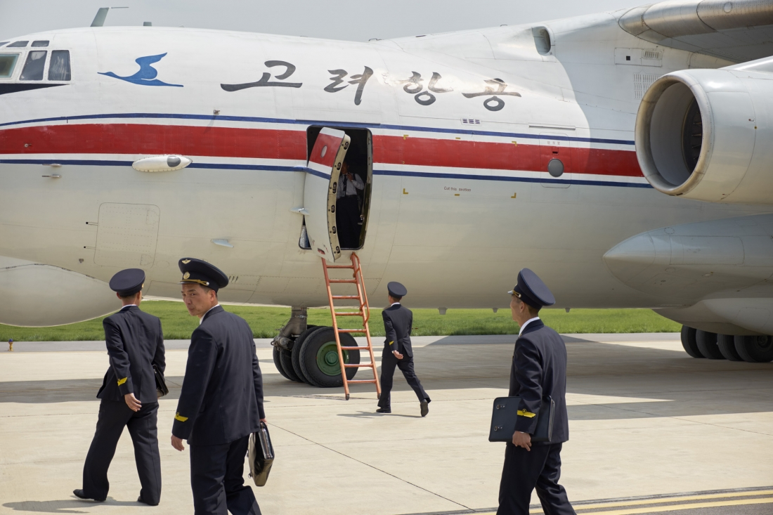 Pilots board an Ilyushin-76 transport plane