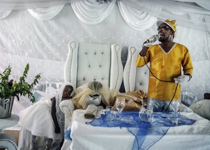 Moses Hlongwane, otherwise known simply as Jesus, giving a sermon during his wedding to Angel, one of his disciples. In Moses' theology, his wedding day was the start of the End of Days. South Africa, 2016   © Jonas Bendiksen/ Magnum Photos