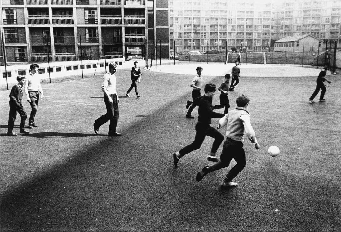 Roger Mayne, Boys playing football, Park Hill Estate, Sheffield, 1961 © Roger Mayne Archive / Mary Evans Picture Library