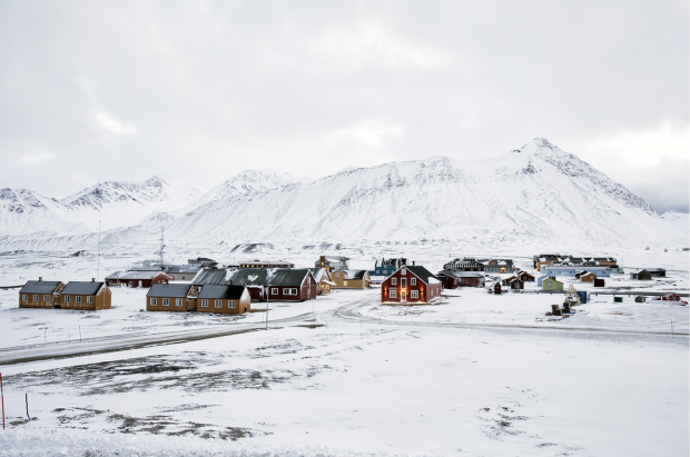 RESEARCH AT THE END OF THE WORLD  Ny Alesund settlement, Svalbard  The Research Centre, formerly a coal mining town, is the largest laboratory for modern Arctic research in existence. There are representations from 11 countries.  © Anna Filipova