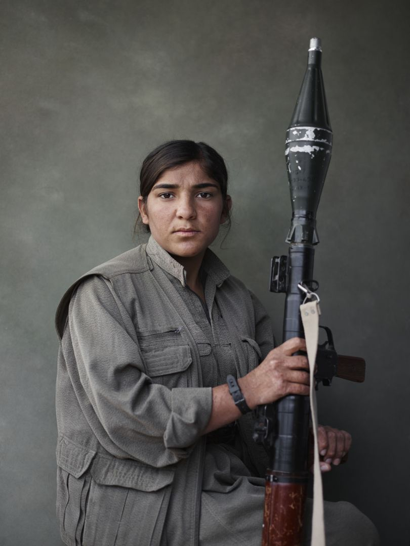 Portrait of Sarya with rocket-propelled grenade launcher. Makhmur, Erbil Governorate, Iraq, March 4, 2015. From [We Came From Fire](https://amzn.to/2L9l8Vm) by Joey L. – published by powerHouse Books