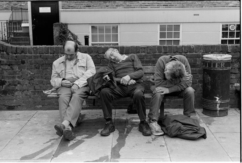 Men sit after the last ever football match at Highbury Stadium before Arsenal move to the new Emirates Stadium. Highbury Corner - 2006