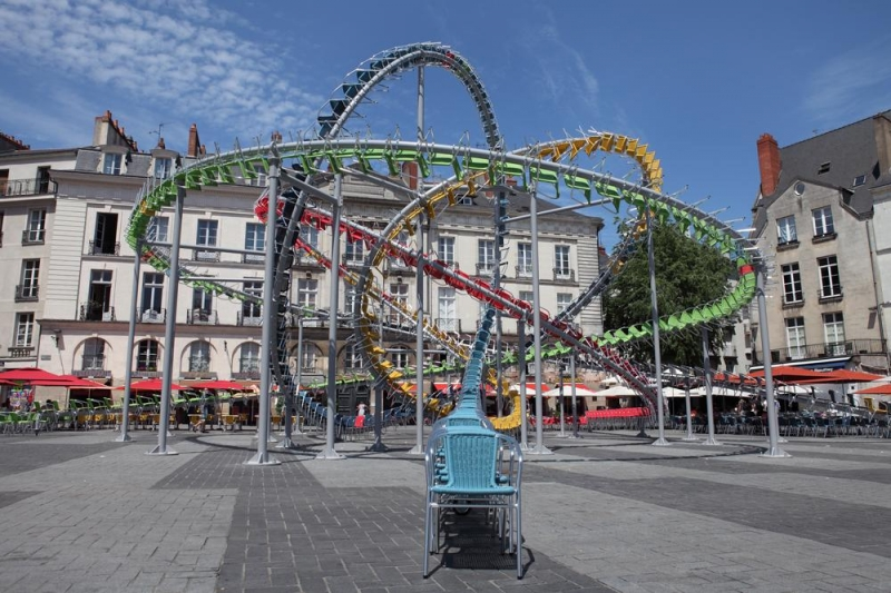 Hundreds of colourful caf chairs create a huge roller - Arts de la table nantes ...