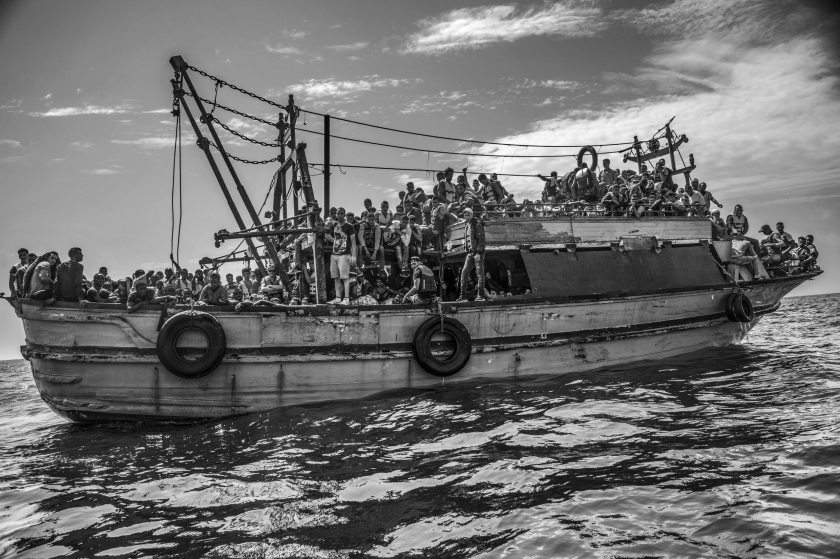 Contemporary Issues, second prize stories: A wooden fishing vessel sails from Libya to Italy carrying more than 500 migrants. Francesco Zizola.