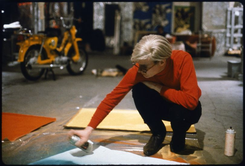 'Andy with Spray Paint and Moped', The Factory, New York, 1965. © Nat Finkelstein Estate