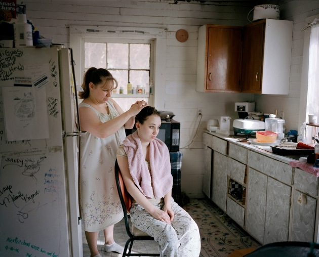 This photo was shot in a dying coal-mining town, St Charles, which is situated in the beautiful Appalachian Mountains behind the fog. © Hannah Modigh. Portrait Single Image Winner, Magnum and LensCulture Photography Awards 2016