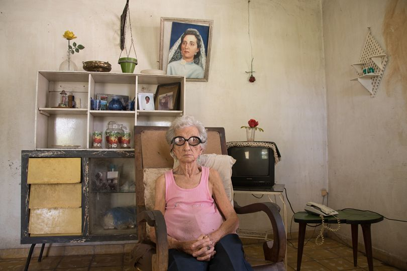 Carmen Sajeras, is an 85 years old lady who was born in Cuba, from an Spanish emigrant family although she feels 100% percent Cuban, she stills live in a nostalgic of the years before the Revolution and imagining how hers family used to live in Spain | © Anisleidy Martínez Fonseca, Cuba, Shortlist, Open, Portraits, 2017 Sony World Photography Awards