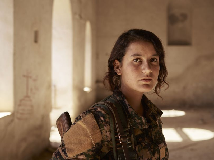 Perwîn, a volunteer YJÊ fighter, inside an abandoned Christian church. Shengal, Nineveh Governorate, Iraq, November 11, 2016. From [We Came From Fire](https://amzn.to/2L9l8Vm) by Joey L. – published by powerHouse Books