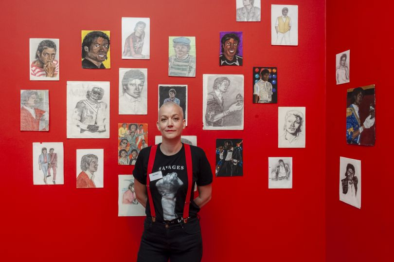 Dawn Mellor with her work, Drawings of Michael Jackson 1984-6. Photograph by Jorge Herrera