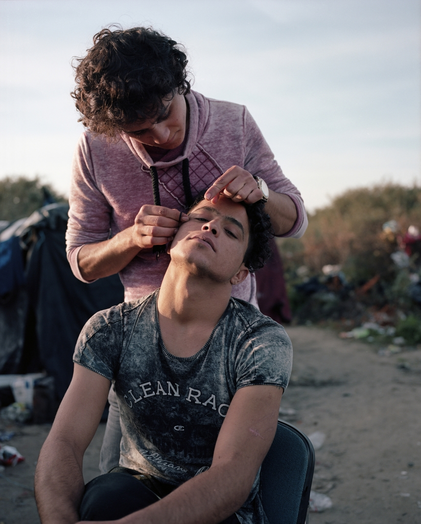 Calais, France, November 2015 North African men threading their eyebrows.