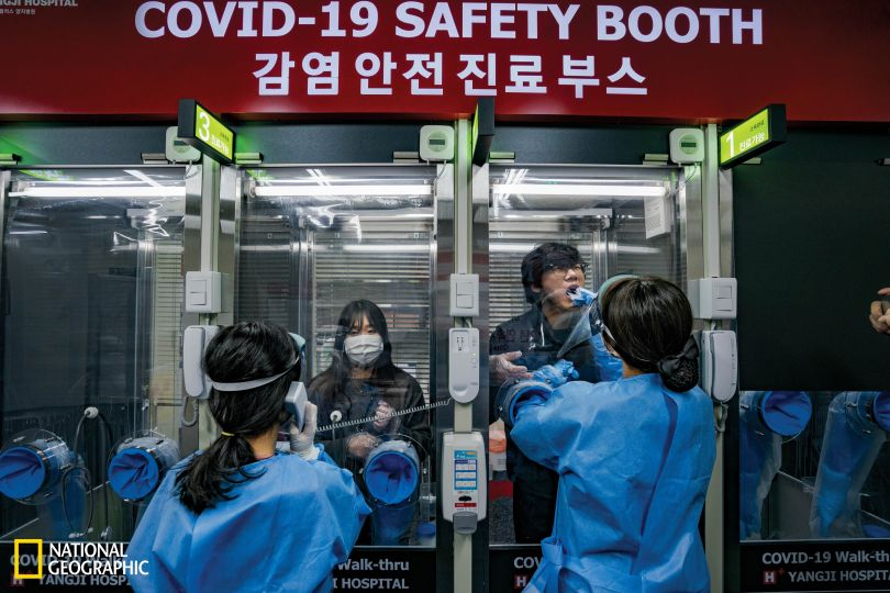At the H Plus Yangji Hospital in Seoul, a walk-in testing clinic is set up like a row of phone booths to prevent contact between patients and medical staff. Nose and mouth swabs take less than three minutes, and test results can be returned in four to six hours. Experience with previous disease outbreaks prepared South Korea for the COVID-19 pandemic. The country already had a legal framework for contact tracing, and most residents stayed home and wore masks in public. The government worked with the private sector to swiftly ramp up testing. There are hundreds of testing sites throughout the country. (Jun Michael Park/National Geographic)