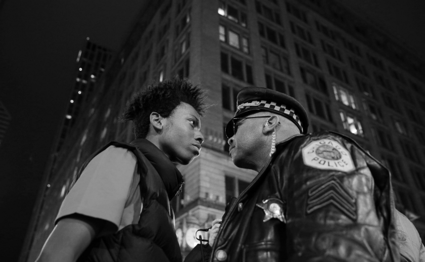 Contemporary Issues, third prize singles: Lamon Reccord stares down a police sergeant during a protest following the fatal shooting of Laquan McDonald by police in Chicago, Illinois, USA. John J. Kim.