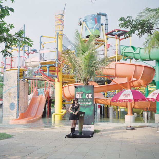 All images © Rocco Rorandelli and courtesy of GOST Books. Jakarta, Indonesia A salesperson promoting Djarum Black Menthol cigarettes during a music parade, organised by Djarum, inside a waterpark.