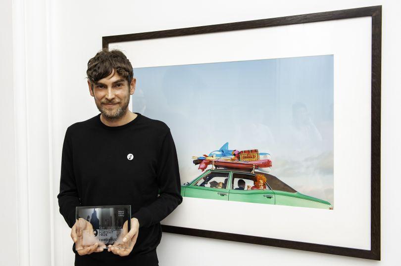 Third prize winner Garrod Kirkwood with his portrait. Photograph by Jorge Herrera