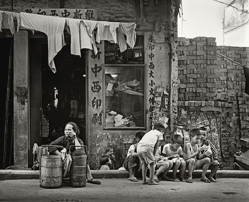 Fan Ho 'Work and Play(成人工作・小孩玩樂)' Hong Kong 1950s and 60s, courtesy of Blue Lotus Gallery