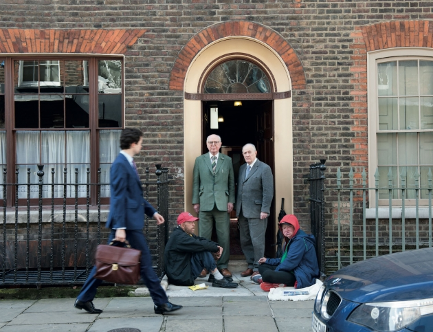 Early morning. The Artists set out for breakfast at Jeff's Cafe in nearby Brune Street. Seated are the Artist's friends George Crompton and Tara McKerr. Image courtesy Gilbert & George / White Cube