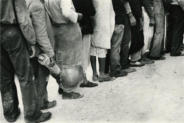 Migrant Vegetable Pickers Waiting in Line to be Paid, Near Homestead, Florida, 1939 © Marion Post Wolcott courtesy Huxley-Parlour Gallery