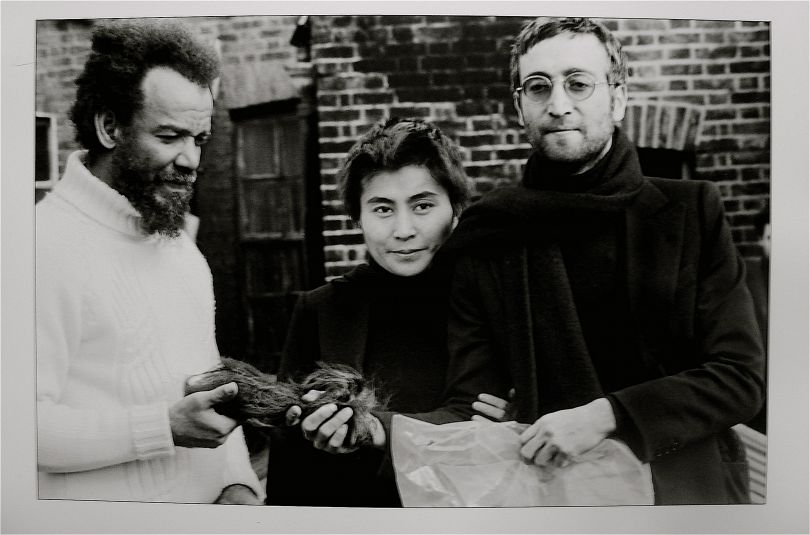 John Lennon giving Michael X his hair to auction, 1969. © Horace Ové