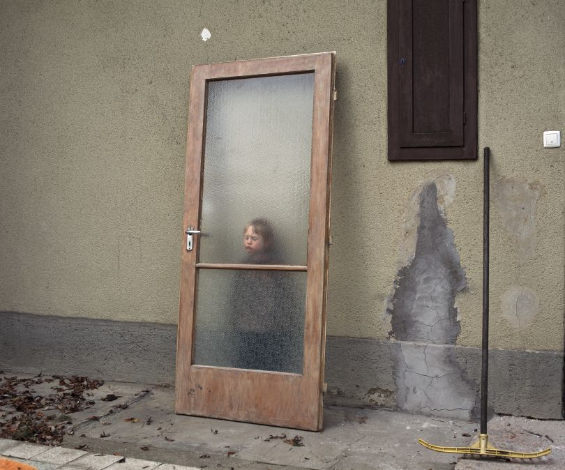 Momó with door, From the Series Middle, 2011  Momó with door, From the Series Middle, 2011. © Gábor Arion Kudász