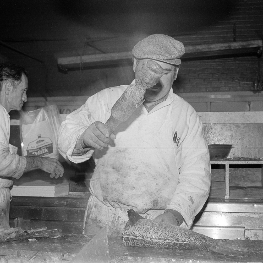 Slicing Fish at the Essex Street Market, NY, March 1978 © Meryl Meisler