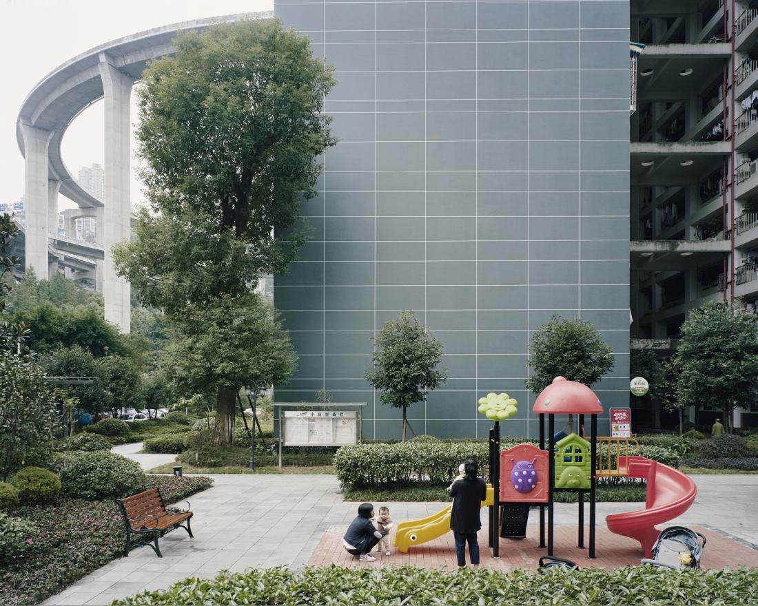 Courtyard of an apartment complex near Caiyuanba Bridge, Chongqing, 2017 © Yan Wang Preston
