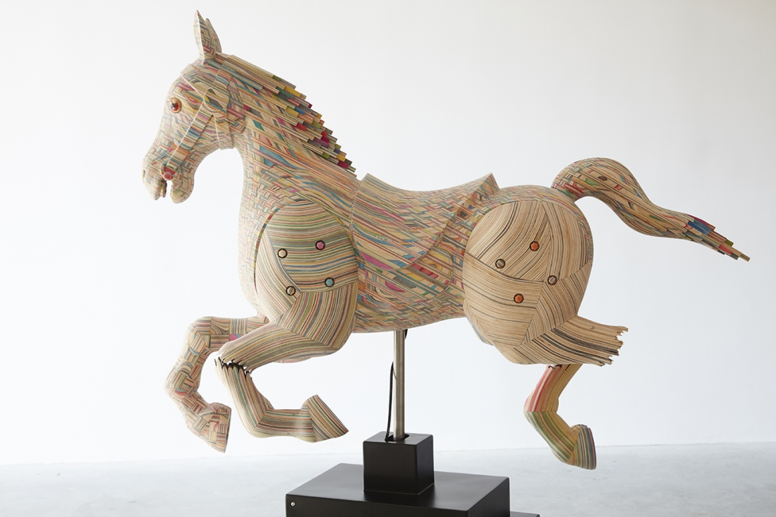 Beautiful sculptural wooden horses made out of broken skateboards