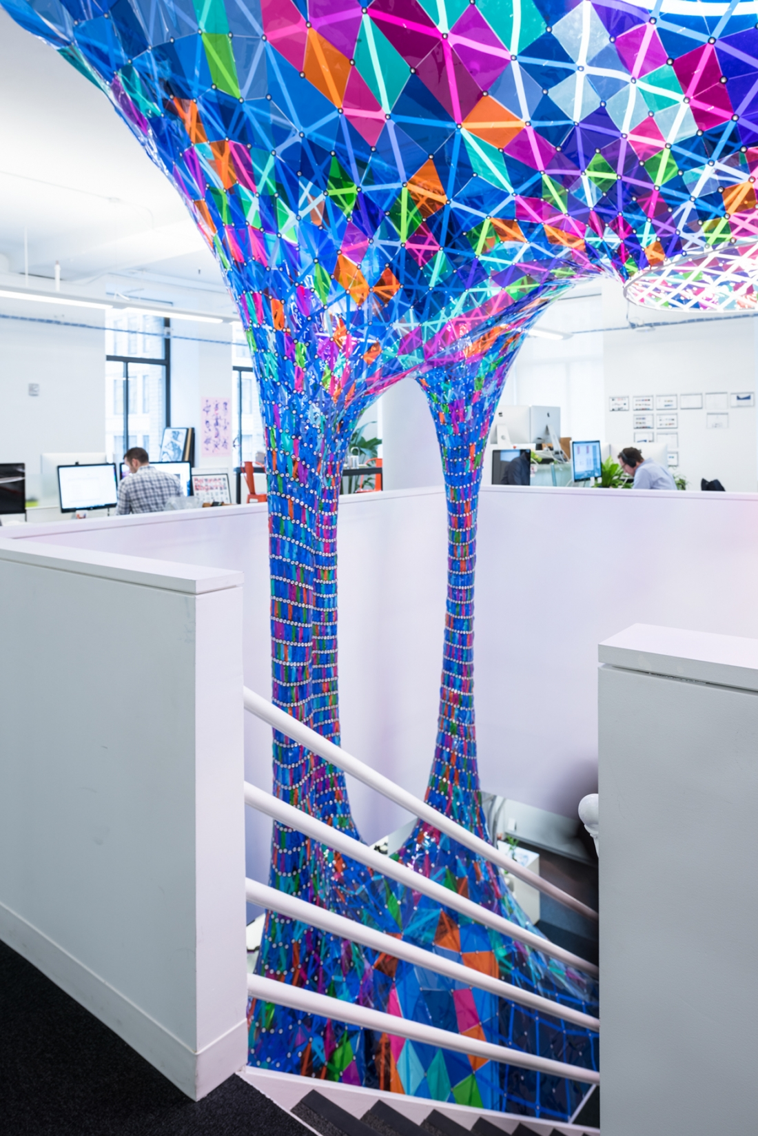 Stain Glass Art Installation That Hangs Through Two Floors