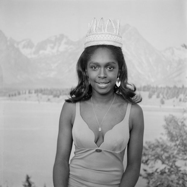 (unidentified) Beauty queen posing in front of alpine backdrop, London, 1970s. From the portfolio 'Black Beauty Pageants'. © Raphael Albert, courtesy Autograph ABP