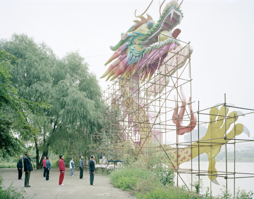 People doing morning exercise in front of a dragon lam, Gansu, 2011 © Zhang Kechun