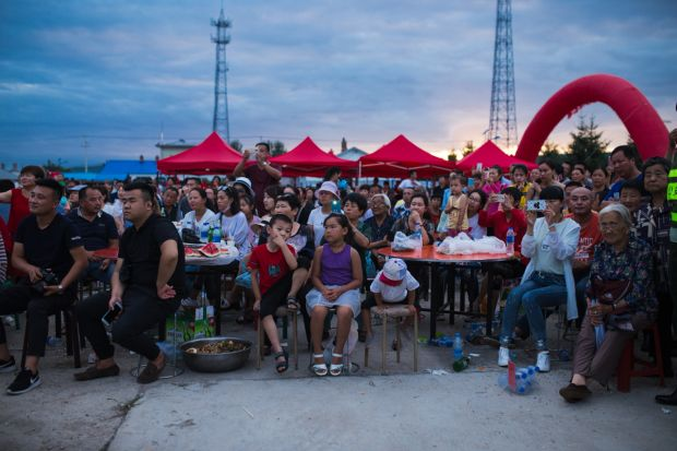 Xin'e Oroqen Settlement, August 2017 A crowd gathers to watch the annual Fire Festival in Xin'e, Heilongjiang Province.