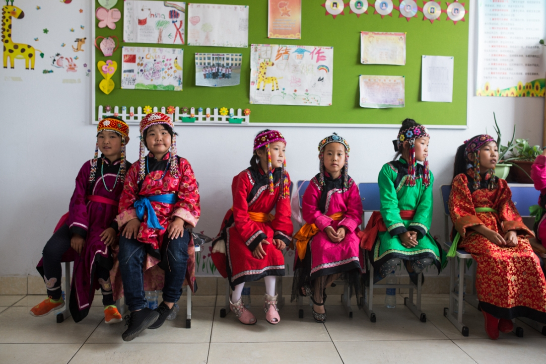 Oroqen School, Heilongjiang Province, July 2017 At Oroqen schools, the curriculum attempts to counter a dwindling of the ethnic minority's language, working lessons in Oroqen into their students' weekly schedule. Online platforms are being developed to engage younger learners, however the language remains under threat of extinction. Oroqen children are a minority at the school, with only two of the children pictured having Oroqen lineage.