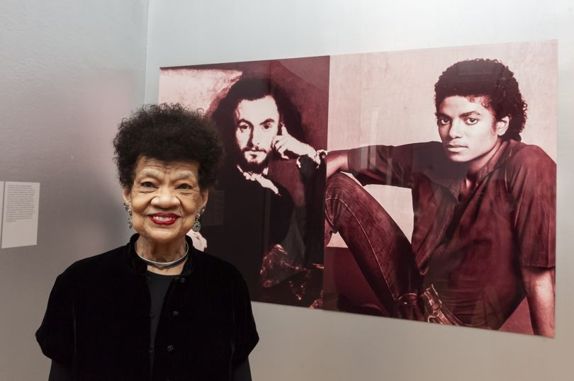 Lorraine O'Grady with her work, The First and Last of the Modernists, Diptych 1 Red (Charles and Michael) 2010. Photograph by Jorge Herrera