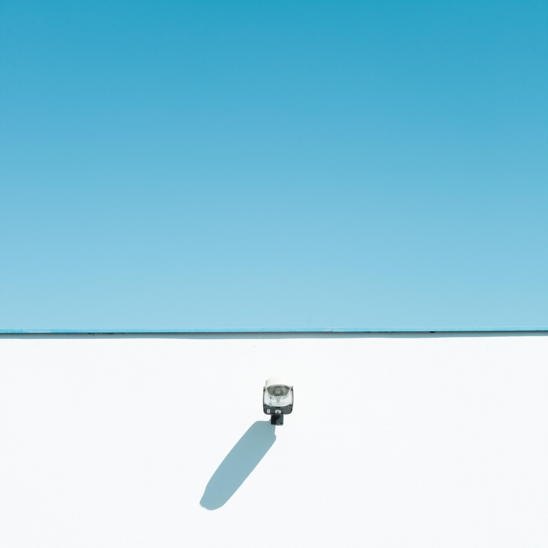 geometric minimalist photography of pastel coloured buildings by