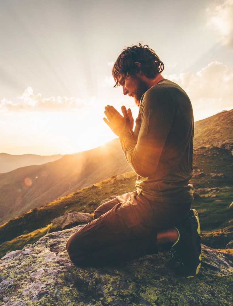 ID: [154274438](https://stock.adobe.com/images/man-praying-at-sunset-mountains-travel-lifestyle-spiritual-relaxation-emotional-concept-vacations-outdoor-harmony-with-nature-landscape/154274438?prev_url=detail)