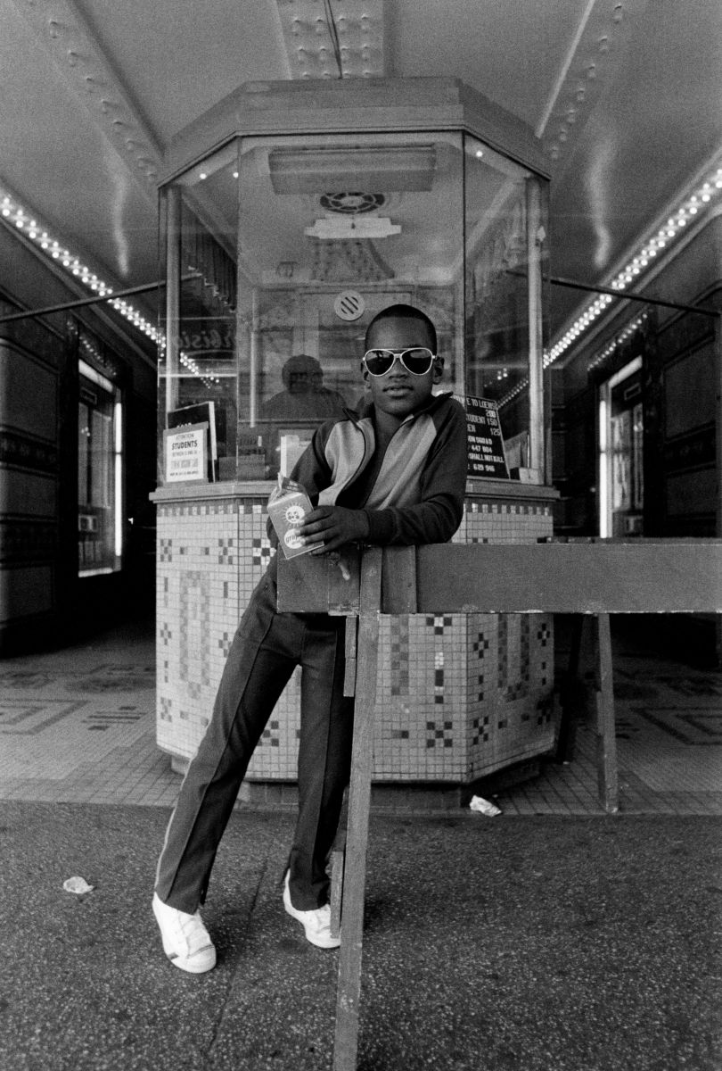 Dawoud Bey A Boy in Front of the Loew's 125th Street Movie Theater 1976, Printed by 1979 Gelatin Silver print 230 x 150