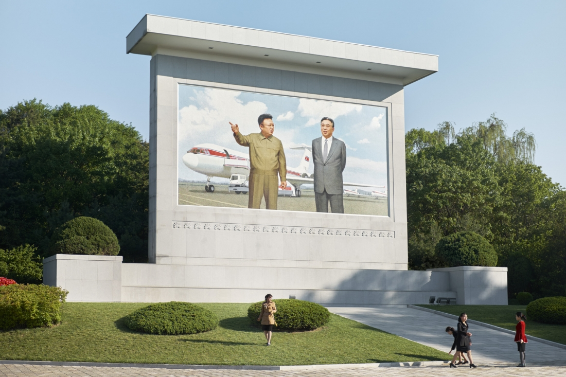 A Mosaic monument near Sunan airport featuring the former leaders of North Korea standing before an Ilyushin-62 and a Tupolev-154