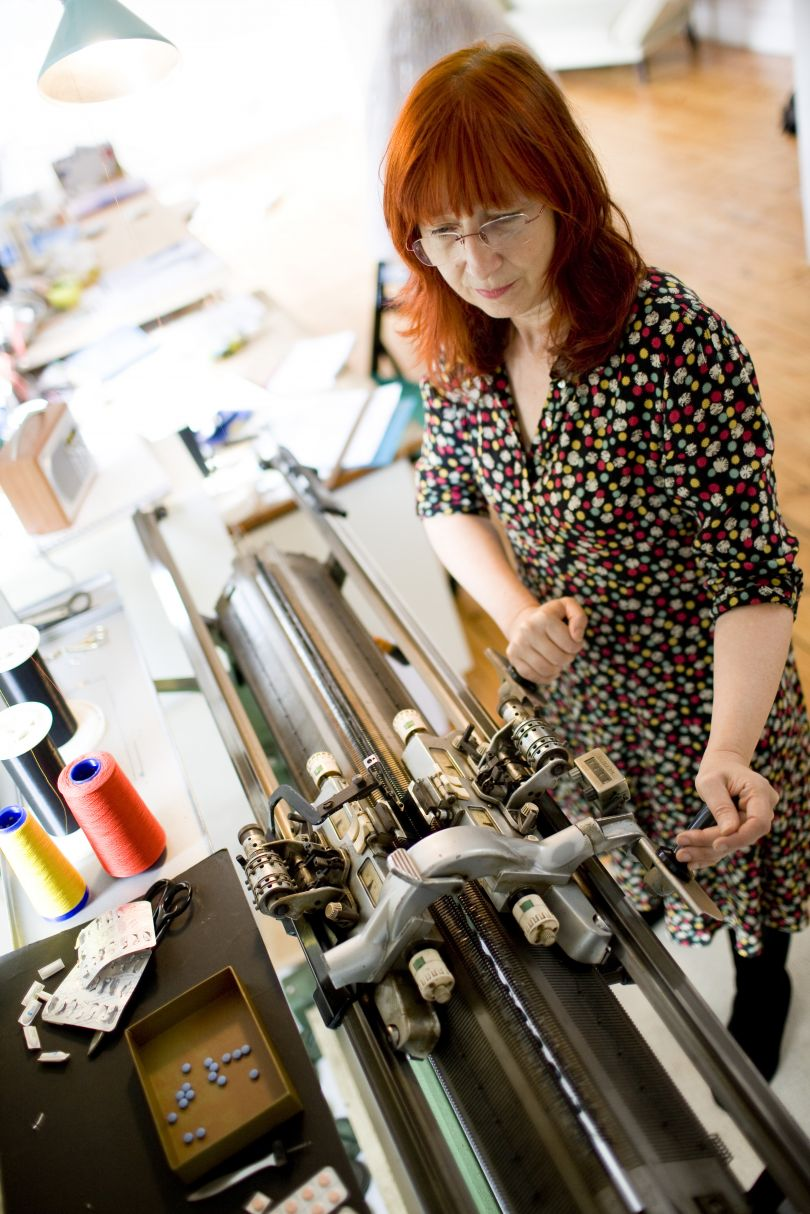 Susie Freeman with her knitting machine. Photography by Tom Lee