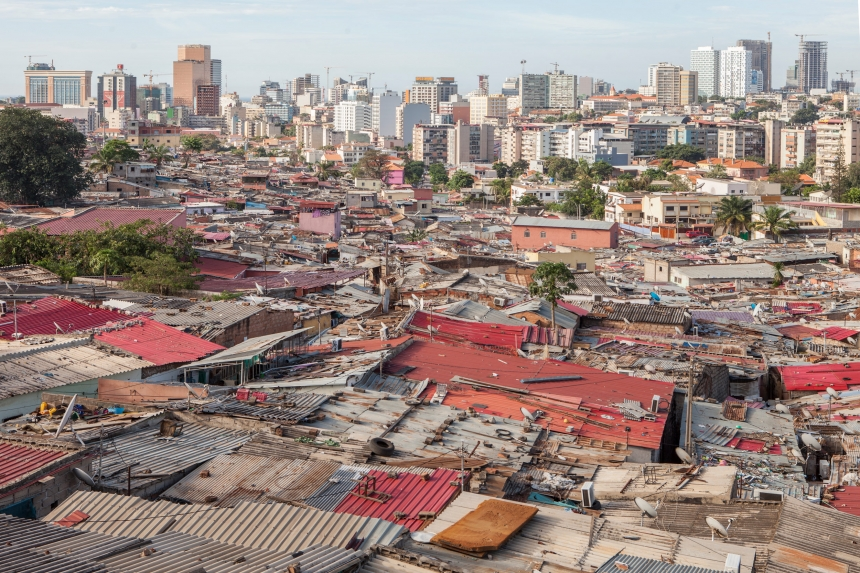 The line which divides the shacks of poor neighbourhoods from the rich area of Luanda