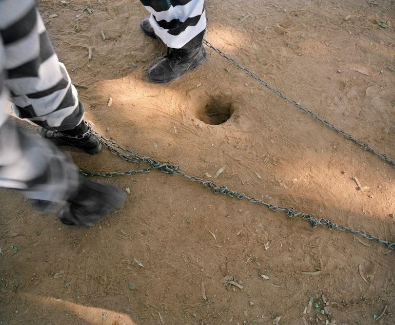 Inmates on chain gang duties