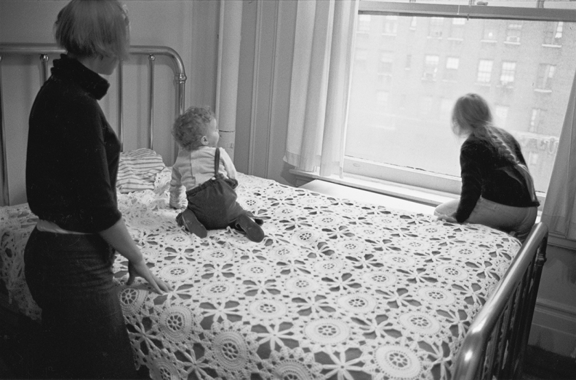 Jenny, Ulrika, and Monika on Swedish grandmother's bedspread looking out the window toward Broadway at West 89th Street, 1967