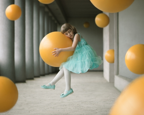 Girl in weightlessness holding a ball, among many others. The child represents gentleness and fragility. Associated with the ball, expressing the lightness, it is the word innocence that is symbolized. For this image, time would be synonymous with gravity. In Grenoble South-East of France, April 9, 2016 | © Alex Andriesi, Romania, Shortlist, Open, Enhanced, 2017 Sony World Photography Awards