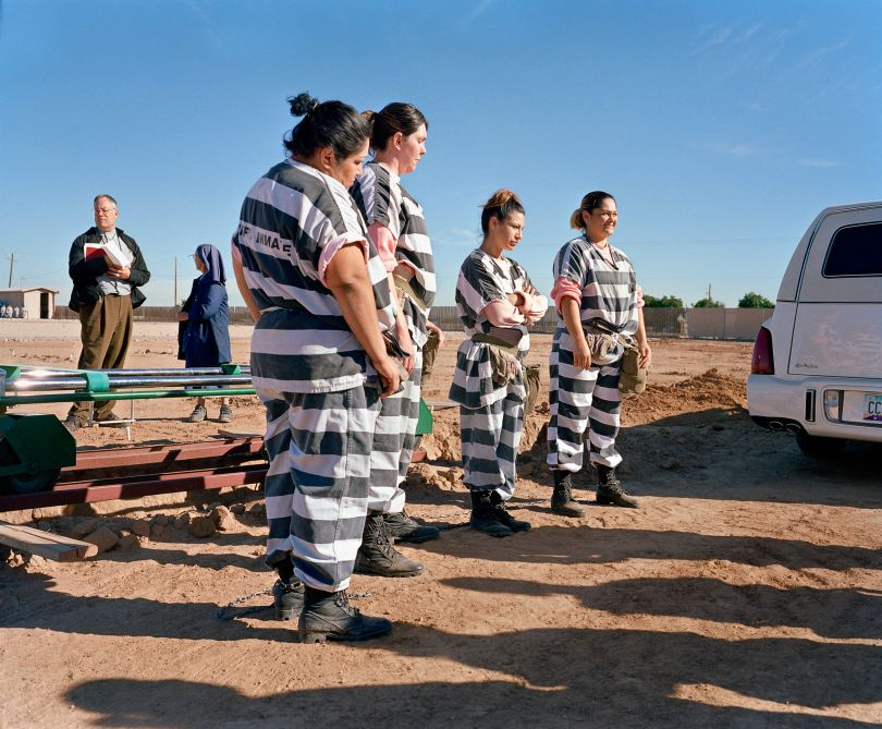 """Inmates wait for a coffin during """" burial duty, """" at Whitetanks cemetery"""
