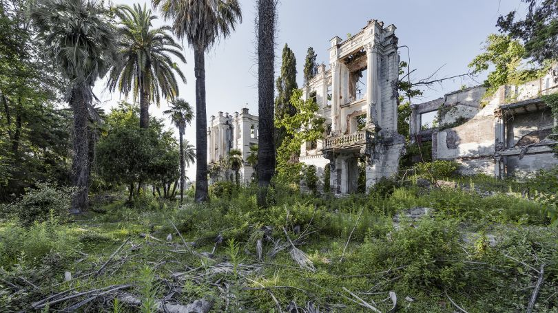 The remains of a sanatorium alongside the Russian Riviera. Benefiting from a sub-tropical climate, this region was immensely popular for the Soviet-elite during the USSR era. This particular sanatorium was built in the early 1900s and severed heavily by shelling and gunfire during the Abkhaz-Georgian conflict. Sokhum, Abkhazia. © Reginald Van de Velde